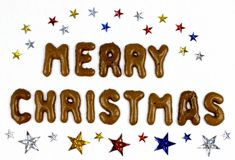 与星的圣诞快乐字法 图库摄影