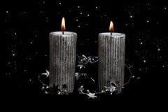 与星的圣诞节银色蜡烛 免版税库存照片