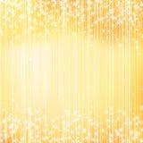 与星的明亮的金黄假日背景 免版税库存照片