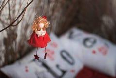 与星的红色天使 免版税图库摄影