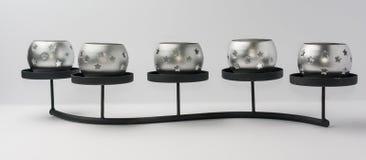 与星的Tealight蜡烛在金属站立正面图 免版税库存图片