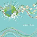 与春天花和卷曲丝带的行星地球 免版税图库摄影