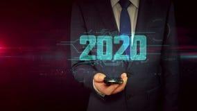 与智能手机和年2020年全息图概念的商人 库存例证
