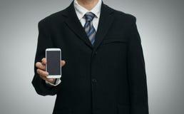 与智能手机的商人 免版税库存图片