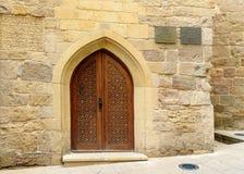 与曲拱的传统木门在老城市, Icheri Sheher 秃头 免版税库存图片