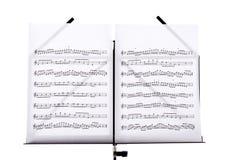 与曲调板料的乐谱架 免版税库存照片