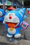 与更改照相机的衣裳的Doraemon形象 免版税库存图片