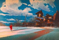 与木房子的冬天风景在圣诞夜里 库存照片