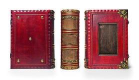 与木板材的大和厚实的年迈的红色皮革书 库存照片