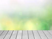 与木板条的抽象五颜六色的Bokeh背景 免版税库存照片