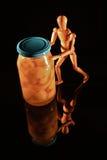 与木玩偶的水果罐头 免版税库存图片