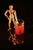 与木玩偶的水果罐头 库存照片