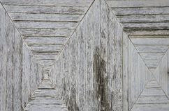 与木篱芭的背景在灰色 免版税库存照片