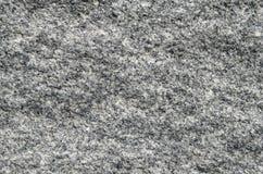 与未经治疗表面har的自然石灰色花岗岩背景 图库摄影