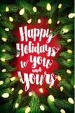 与杉木花圈和假日问候的印刷圣诞卡 免版税库存图片