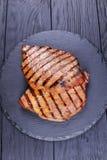 与条纹的两块烤牛排 图库摄影