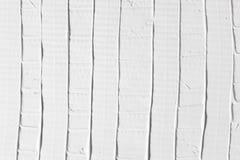 与条纹的安心白色表面,灰泥背景 免版税图库摄影