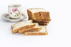 与杯子的面包 库存照片