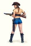 与枪的女牛仔猎人 免版税图库摄影