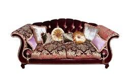 与查出的枕头的沙发 免版税库存图片