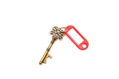 与标签的一把古色古香的钥匙 免版税库存照片