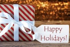 与标签的大气圣诞节礼物,节日快乐 库存图片