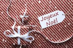 与标签的礼物,雪花,茹瓦约Noel意味圣诞快乐 免版税图库摄影