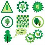 与树、叶子和花的Ecologus流动标志 免版税库存照片