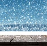 与树和雪的蓝色圣诞节背景 库存图片