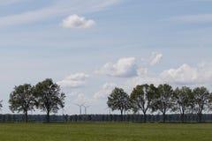 与树和风车的风景 图库摄影