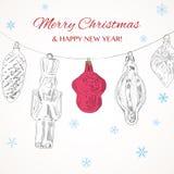 与树玩具的葡萄酒手拉的圣诞快乐贺卡 库存图片