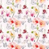 与桃红色橙色兰花的热带无缝的样式开花 在白色背景隔绝的热带花卉墙纸 异乎寻常 图库摄影