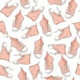 与桃红色运动鞋的无缝的样式 体育运动背景 免版税库存图片