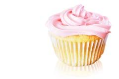 与桃红色结霜的香草杯形蛋糕 库存照片