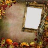 与框架、秋叶和伞的葡萄酒背景 免版税库存图片