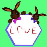 与框架在手上,在白色背景的动画片的两巧克力兔宝宝 向量例证