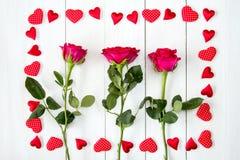与框架的三朵玫瑰从心脏 库存照片