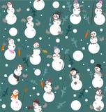 与桶、起动、手套、红萝卜和冷杉的滑稽的雪人s分支 库存图片
