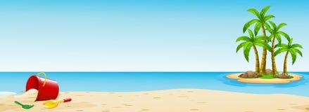 与桶的场面在海滩 库存照片