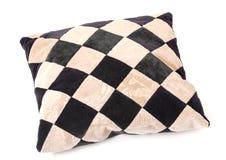 与棋盘纹理的羽绒枕头 库存照片