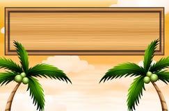与椰子树的一块空的木牌 免版税库存照片