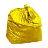 与概念的黄色垃圾袋黄色垃圾袋的颜色是在白色背景隔绝的再造废物 免版税库存照片