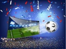 与橄榄球的横幅飞行在电视外面 免版税图库摄影