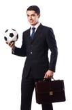 与橄榄球的年轻商人 免版税库存图片