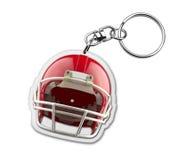 与橄榄球盔甲标志的礼物keyholder 库存图片