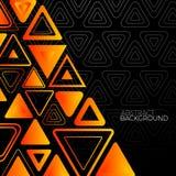 与橙色三角的抽象黑背景 免版税库存图片