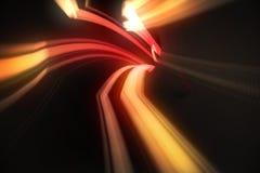 与橙色光的红色漩涡 库存照片