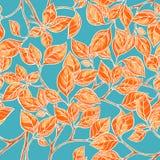 与橙色叶子的无缝的背景 库存照片