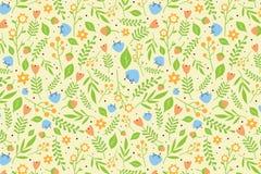 与橙色和蓝色花的花卉样式 免版税库存照片