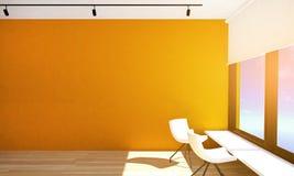 与橙色墙壁和镶花地板的空的室内部与大窗口和天花板灯 免版税图库摄影